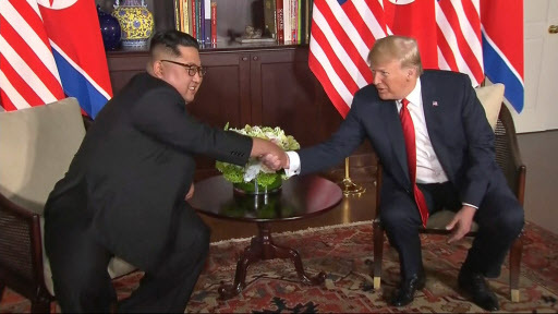 In this image made from video provided by Host Broadcaster Mediacorp Pte Ltd,, US President Donald Trump and North Korean leader Kim Jong-un shake hands ahead of their meeting at Capella Hotel in Singapore, Tuesday. (Host Broadcaster Mediacorp Pte Ltd via AP)
