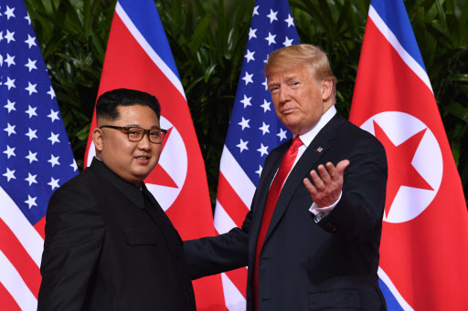 US President Donald Trump (right) gestures as he meets with North Korea`s leader Kim Jong-un at the start of their historic US-North Korea summit, at the Capella Hotel on Sentosa island in Singapore on Tuesday. (AFP)