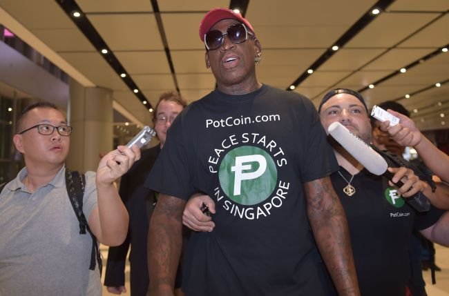Retired American professional basketball player Dennis Rodman speaks to the press as he arrives at Changi International airport ahead of US-North Korea summit in Singapore on June 11, 2018.(AFP)