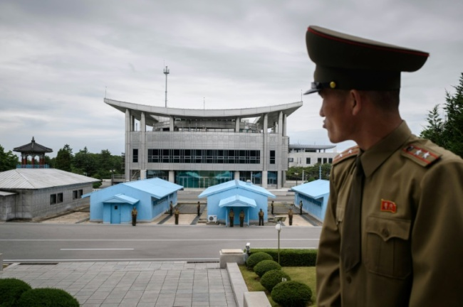 Korean People's Army soldier Lieutenant Colonel Hwang Myong-jin is upbeat about the Singapore summit as an opportunity to showcase the nation before the world. (AFP-Yonhap)