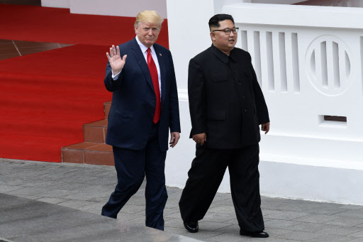 US President Donald Trump and North Korea leader Kim Jong-un walk from lunch at the Capella resort on Sentosa Island Tuesday in Singapore. (AP)