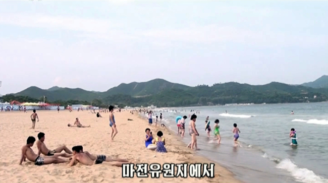 Pyongyang`s mouthpiece Korea Central News Agency broadcasts about North Koreans relaxing on a beach.