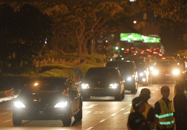 North Korean Leader Kim Jong-un is seen on the road at Singapore's Changi Airport on Tuesday, after the summit between US leader Donald Trump and North Korea leader Kim. (AP)