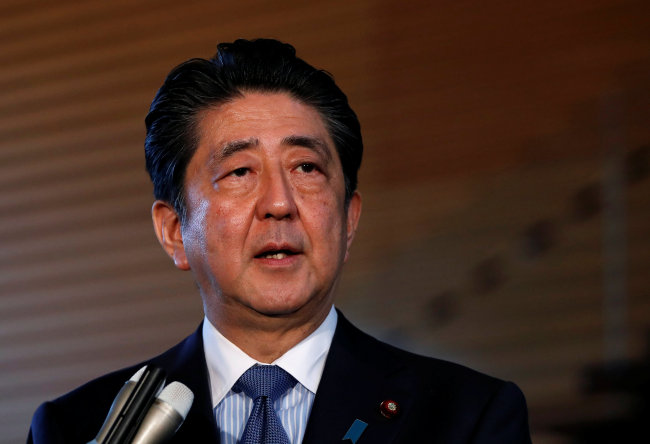 Japan`s Prime Minister Shinzo Abe speaks to media after the news conference by the US President Donald Trump, after the summit between the US and North Korea in Singapore, at Abe`s official residence in Tokyo, Japan, Tuesday. (Reuters-Yonhap)