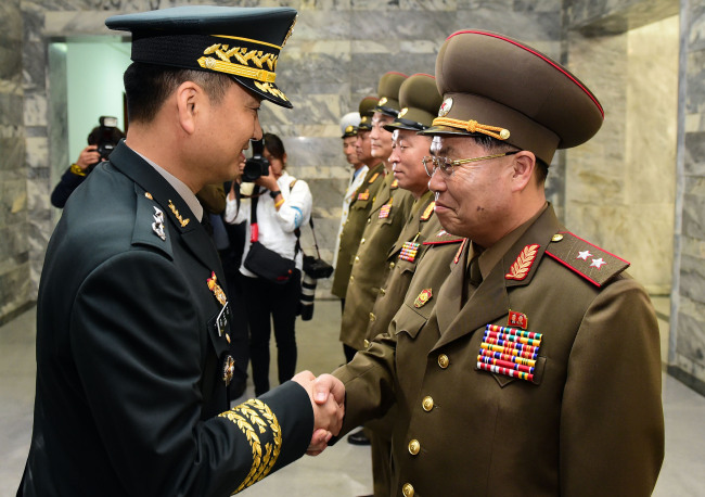 Military officials from the two Koreas hold rare talks at the inter-Korean truce village of Panmunjeom on Thursday, in this photo released by the joint press corps. (Yonhap)