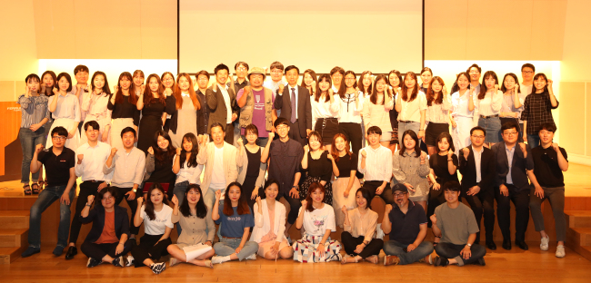 Korean adults and youths pose at the launching event for this year's public diplomacy programs organized by the Korea Foundation at the Ferrum Tower in Seoul on Friday. (Korea Foundation)
