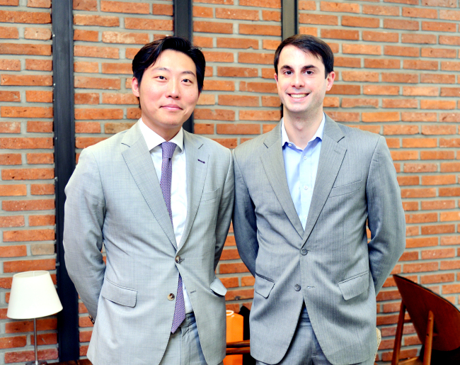 Due West co-founders Michael J. Novielli (right) and Andrew Sohn pose after an interview at The Korea Herald headquarters in Seoul on Friday. (Park Hyun-koo/The Korea Herald)