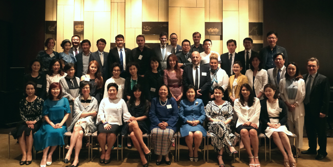 Members of the Korea CQ Forum pose for a group photo at Grand Hyatt Seoul on Tuesday. (CICI)