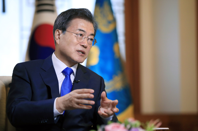 In the photo provided by South Korea`s presidential office Cheong Wa Dae, President Moon Jae-in speaks in an interview with Russian news outlets at his office on June 20, 2018, one day before he was set to embark on a three-day state visit to Russia for a bilateral summit with Russian President Vladimir Putin. (Yonhap)