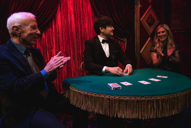 Magician Ed Kwon performs magic at The Magic Castle in Los Angeles, California in December 2017.