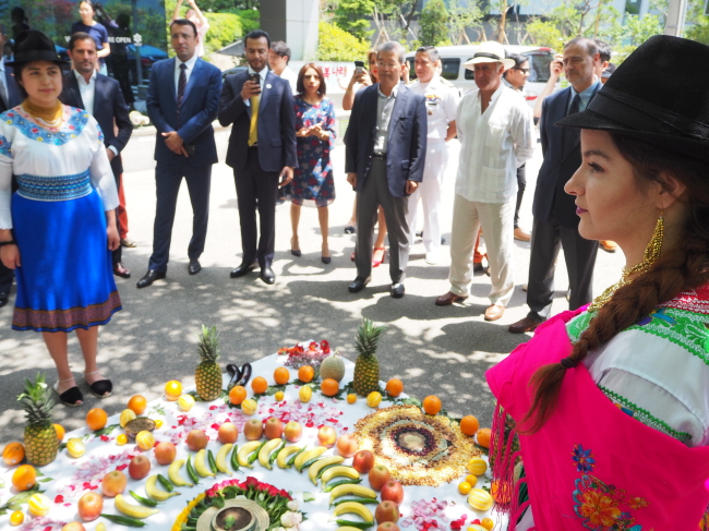 Foreign ambassadors and diplomats participate in an Inti Raymi celebration organized by the Ecuadorian Embassy and World Culture Open in Seoul on Friday. (Joel Lee/The Korea Herald)