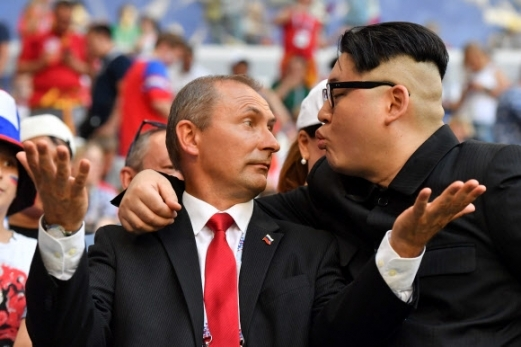 Kim Jong-un and Vladimir Putin impersonators are spotted at Samara Arena in Russia on Monday. (AFP-Yonhap)