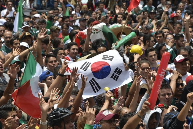 Mexican fans celebrate South Korea's 2-0 victory over Germany on Wednesday. (AFP)