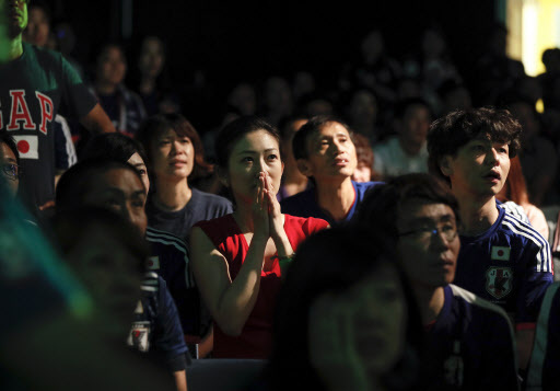 Japanese soccer fans react as they watch Japan receive the third goal from Belgium during the FIFA World Cup 2018 round of 16 soccer match between Japan and Belgium at a public viewing venue in Tokyo, Japan, in the early morning on July 3. EPA