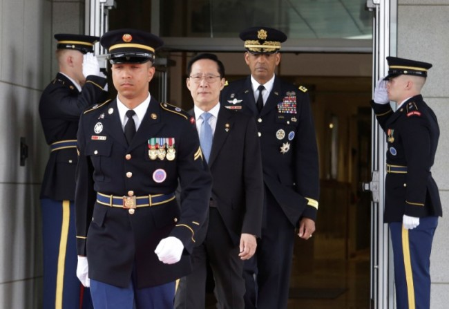 South Korean Defense Minister Song Young-moo and US Gen. Vincent Brooks, commander of the United Nations Command, US Forces Korea and Combined Forces Command, arrive to attend an opening ceremony for the new headquarters of USFK on June 29. (Reuters)
