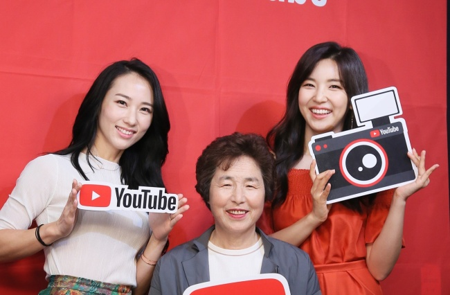 Housewife YouTubers Park Smi, Cho Seong-ja and Choi Seo-young pose for photos before a press event held Wednesday at Google Campus in southern Seoul. (KPR)