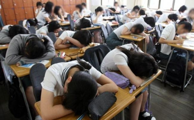 Students take a nap during lunch hours due to chronic fatigue. (Yonhap)
