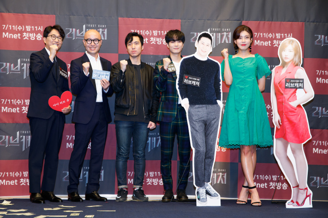 "Panelists of Mnet's upcoming reality show ""Love Catcher"" pose during a press conference in Seoul on Monday. (Mnet)"