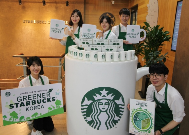 Starbucks Korea employees pose for an announcement made Tuesday to go greener by reducing the use of plastic at stores nationwide. (Starbucks Korea)
