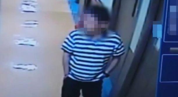 Surveillance footage shows the man walking out of the psychiatric ward in Gwangju. (Yonhap)