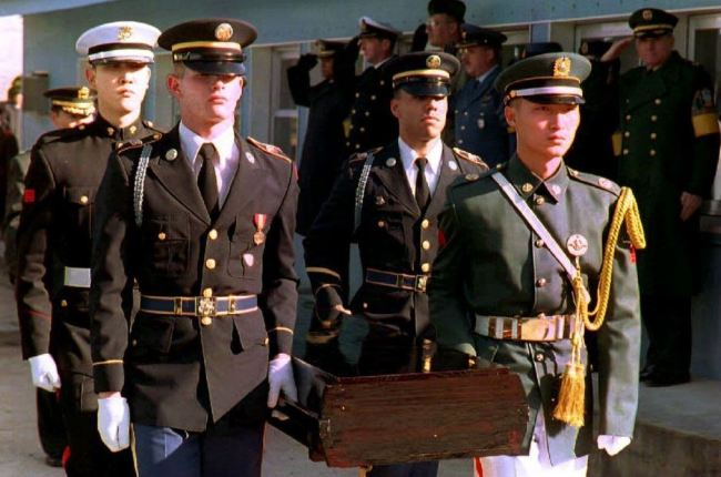 United Nations honor guards in December 1993 carry the remains of a soldier who died during the Korean War. (AFP)