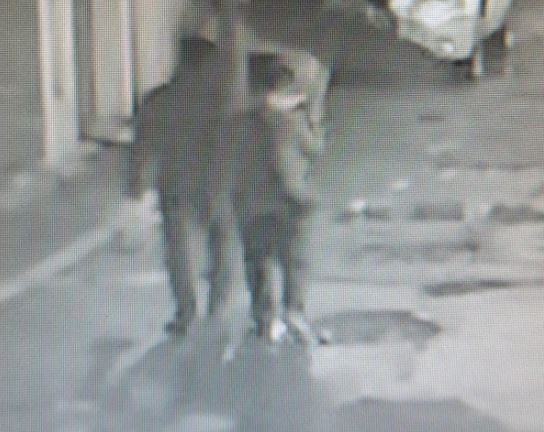 Surveillance footage shows the two in an alley in Daejeon at 11:38 p.m. on March 18. (Yonhap)