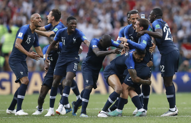 French players celebrate at the end of the final match between France and Croatia at the 2018 soccer World Cup in the Luzhniki Stadium in Moscow, Russia, Sunday, July 15, 2018. (AP)