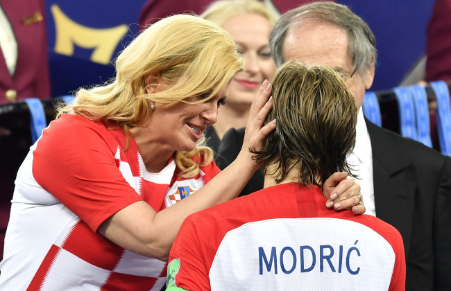 Croatian President Kolinda Grabar-Kitarovic hugs Croatia's Luka Modric after France won the final match between France and Croatia at the 2018 soccer World Cup in the Luzhniki Stadium in Moscow, Sunday, July 15, 2018. (AP)