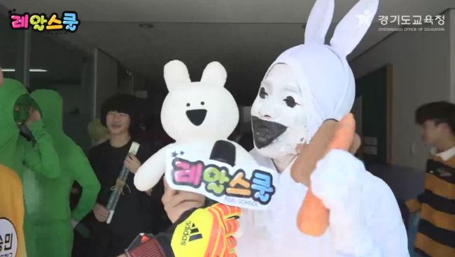 A student dresses up as Line's Over Action Rabbit character and brings a doll along to help explain his costume.