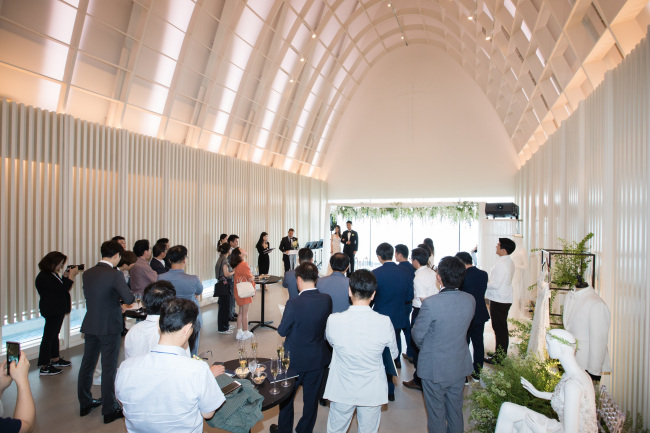 Guests look around the hotel's wedding chapel (Hilton Busan)