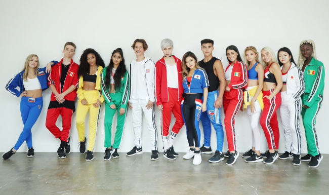 Each member of Now United sports a tracksuit representing their country during a photo session. (Yonhap)