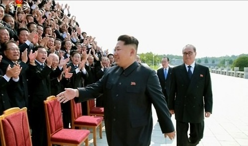 North Korean leader Kim Jong-un prepares to take a photo with officials, when he recalled the heads of the North`s embassies and other missions back to Pyongyang in 2015. (Yonhap)