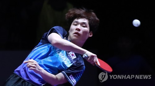 Jang Woo-jin of South Korea hits a shot during the men's doubles final at the International Table Tennis Federation (ITTF) World Tour Platinum Korea Open at Chungmu Sports Arena in Daejeon, 160 kilometers south of Seoul, on July 22, 2018. (Yonhap)