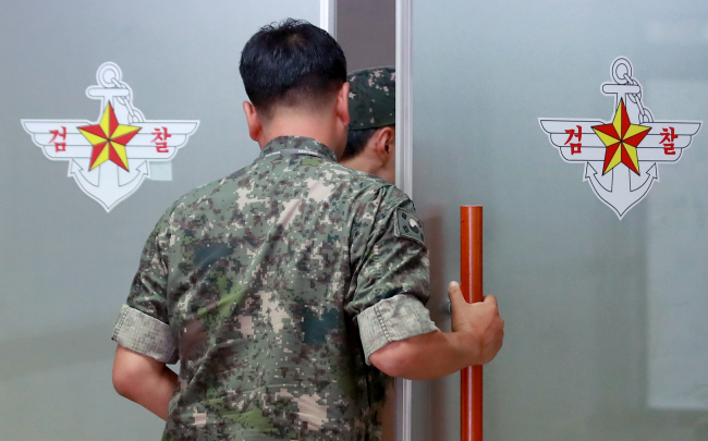 A military official enters the office of the military's special investigation team at the Ministry of National Defense in Seoul on Monday. Yonhap