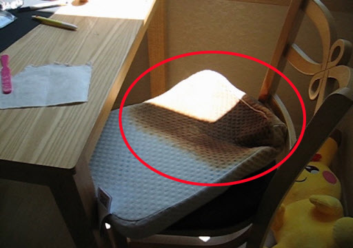 A latex pillow (pictured) placed near a bedroom window burst into flames after being exposed to the blazing sunlight in Busan, Wednesday. (Yonhap)