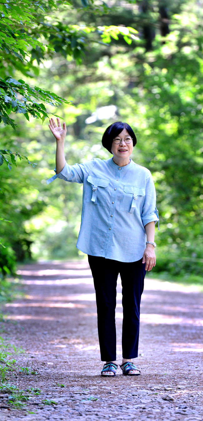 The first female Director General of the Korea National Arboretum Lee You-mi poses at the Manchurian fir section of the arboretum, the plant she aspires to become more like, during an interview in Pocheon, Gyeonggi Province last week. (Park Hyun-koo/The Korea Herald)