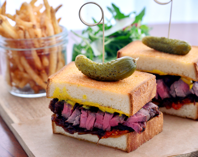 Taupe's steak sandwich features 150 grams of beef grilled to medium-rare and swaddled between two slices of pullman loaf-style bread. The hearty sandwich is served with fries and an arugula and watercress salad. (Photo credit: Park Hyun-koo/The Korea Herald)