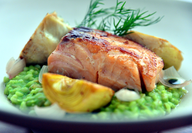 Taupe's popular salmon and green bean risotto pairs rich and juicy salmon that has been brined, cooked sous-vide and then pan-seared with risotto crafted with parsley oil, pea puree and plenty of Grana Padano cheese. (Photo credit: Park Hyun-koo/The Korea Herald)