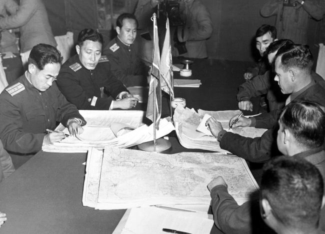 North Korean and UN forces delegates meet at the cross-border village of Panmunjom to discuss an armistice on Oct. 11, 1951. Yonhap