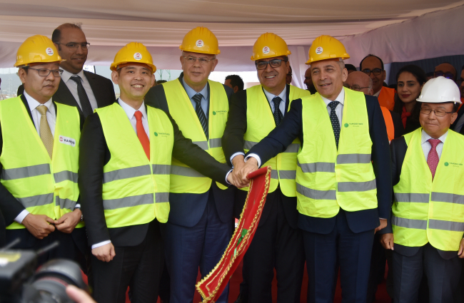 Chairman of Hands Coloration Seung Hyun-chang (second from left) poses during the groundbreaking ceremony for the Morocco factory in April. (Hands Corporation)