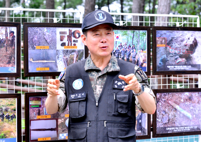 Lt. Col. Ju Gyeong-bae promotes the collection of DNA samples to identify those missing during the Korean War at Gamaksan, Gyeonggi Province, Friday. Park Hyun-koo/The Korea Herald