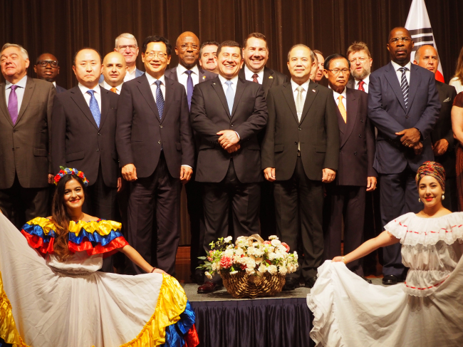 Foreign ambassadors pose at the National Day reception at Lotte Hotel on Thursday. (Joel Lee/The Korea Herald)