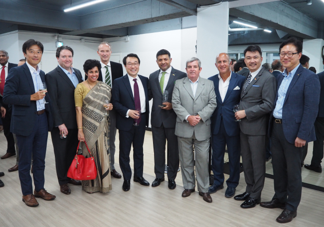 Former Indian Ambassador to Korea Vikram Doraiswami (center) poses with foreign ambassadors and diplomats at his farewell party at the Indian Embassy on July 23. In the photo is Ambassador Lee Do-hoon (left to Doraiswami), representative for Korean Peninsula Peace and Security affairs at the Foreign Ministry. (Joel Lee/The Korea Herald)