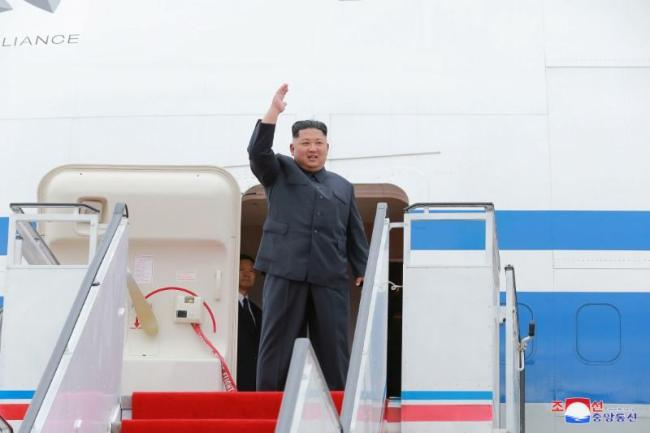 In a file photo, North Korea`s leader Kim Jong-un waves before departing Pyongyang to Singapore on June 10. (KCNA-Reuters)