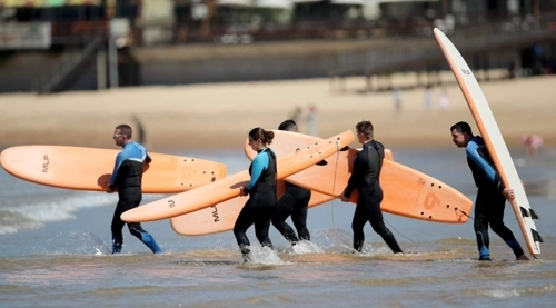 Surfers at Mallipo Beach (Yonhap)