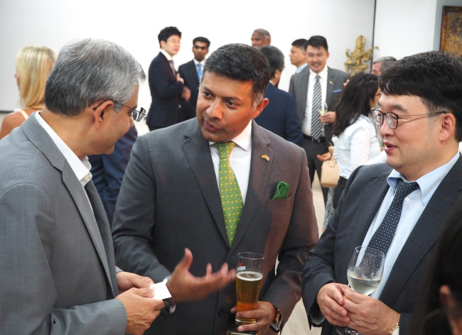 Indian Ambassador to Korea Vikram Doraiswami (center) speaks with guests at his farewell party at the Indian Embassy in Seoul on Jan. 23. (Joel Lee/The Korea Herald)