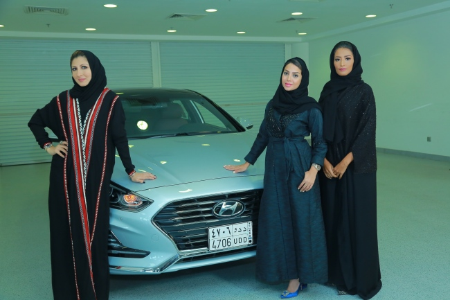 From left: Fashion designer Reem Faisal, entrepreneur Bayan Linjawi, and radio host and travel blogger Shadia Abdulaziz, honorary ambassadors for Hyundai Motor, pose in front of the Hyundai Sonata New Rise. (Hyundai Motor)