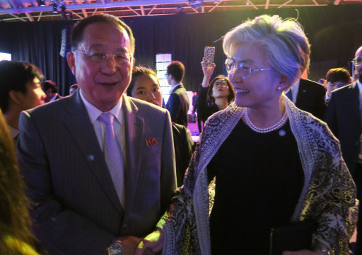 North Korean Foreign Minister Ri Yong-ho (L) and South Korean Foreign Minister Kang Kyung-wha speak at a gala dinner for a regional security forum in Singpaore on Friday.