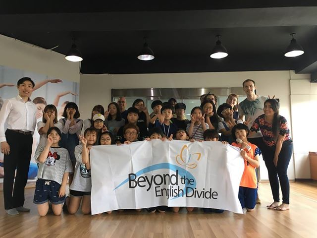 Caption: Students and volunteers of Beyond the English Divide pose for a photo at the July English class. (Aaron Yip/The Korea Herald)