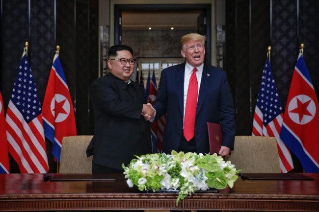 North Korea`s leader Kim Jong-un shakes hands with US President Donald Trump during Singapore summit in June. Yonhap